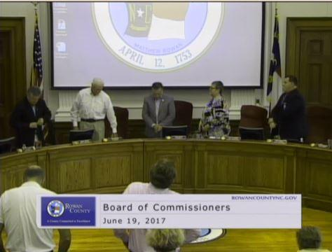 Rowan County Commissioners listen to a chaplain's prayer before a meeting in June 2017.