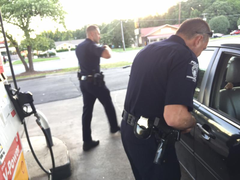 Lt. Abbondanza checks in on a car parked at a gas station pump.