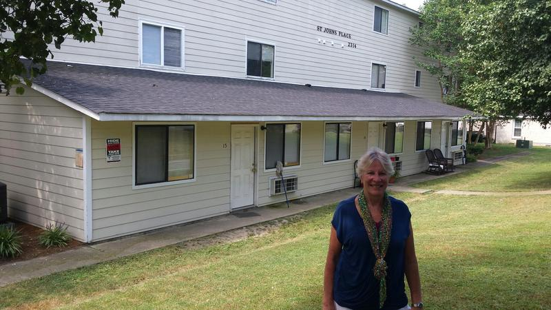 Supportive Housing Communities Executive Director Pamela Jefsen, in front of St. John's Place apartment building.