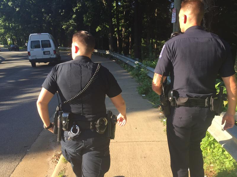 Officers Shue and Epolito walk down Reagan Drive.