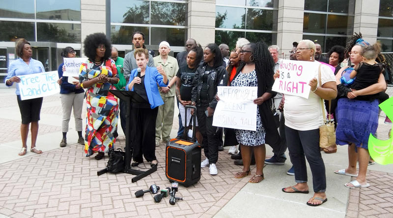Housing advocates held a press conference outside the government center Monday.