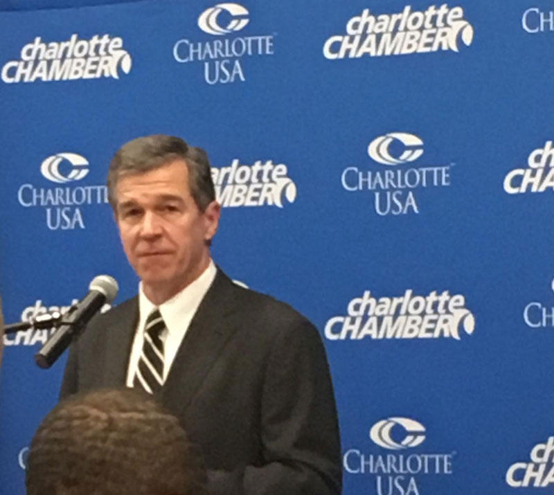 Governor Roy Cooper announces Allstate expansion in Charlotte.