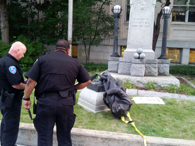 Protesters in Durham Monday pulled down a statue of a Confederate soldier.