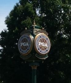 One of numerous PGA logos around Quail Hollow course