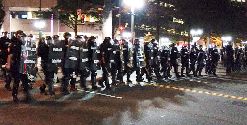 Police in riot gear march down Trade Street toward the Omni Hotel during protests Sept. 21, 2016, after the killing of Keith Lamont Scott.