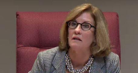 Council Member Julie Eiselt responds to criticism at the council meeting following the police shooting of Keith Scott.