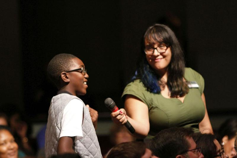 Reporter Sarah Delia takes a comment from an 11-year-old boy who was in our audience.