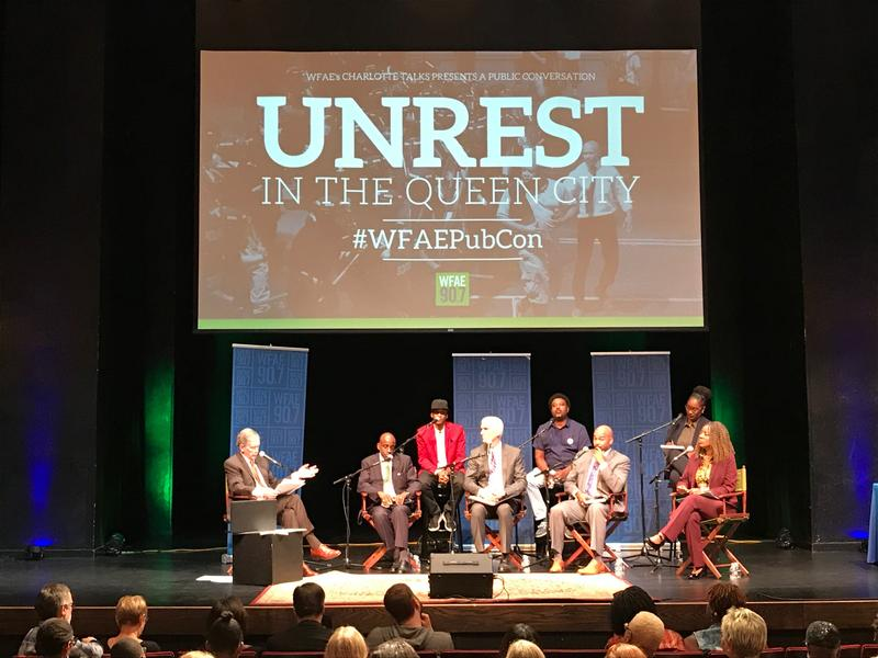 Panelists on stage, clockwise from left: Mike Collins, Greg Jackson, Robert Dawkins, Brenda Tindal, Vicki Foster, Patrick Graham, Patrick Mumford, Nicholas Wharton.