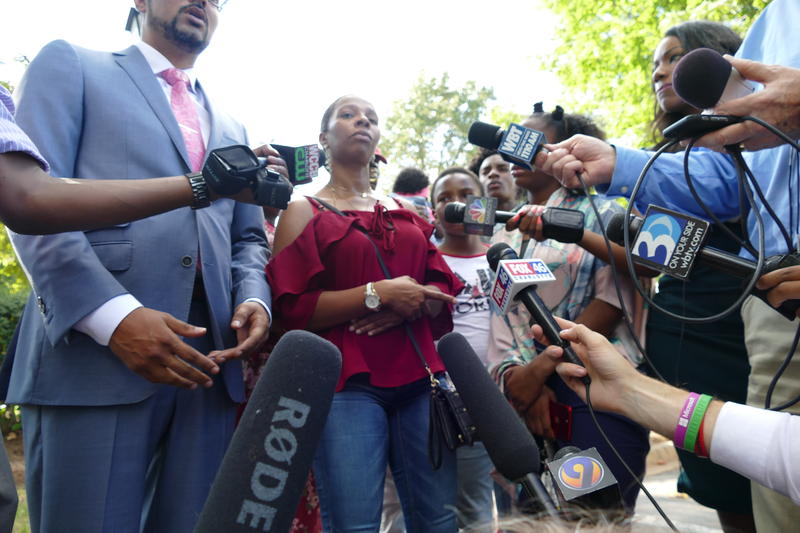 Rakeyia Scott addressed reporters at the north Charlotte apartment complex where her husband was shot one year ago Wednesday.