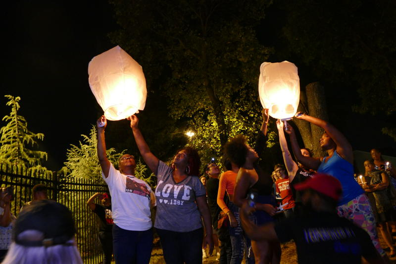 Lanterns were lit in remembrance of Keith Scott and Justin Carr at a vigil held Wednesday night, one year after the Scott shooting.