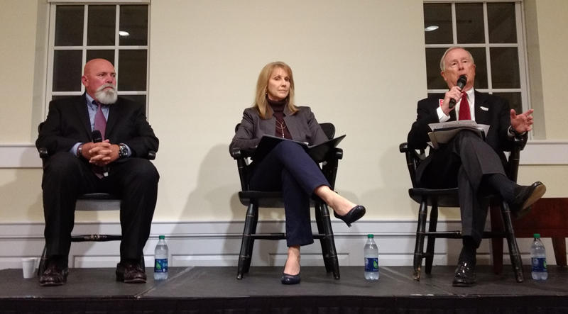 Davidson mayoral candidates (from left) Rusty Knox, Laurie Venzon and John Woods debated Wednesday at Davidson College.
