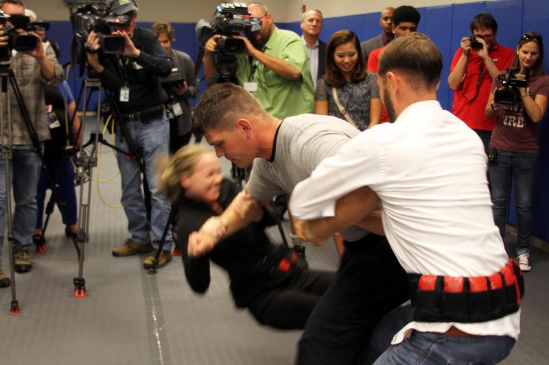 Reporters attempt to take down a pretend suspect.