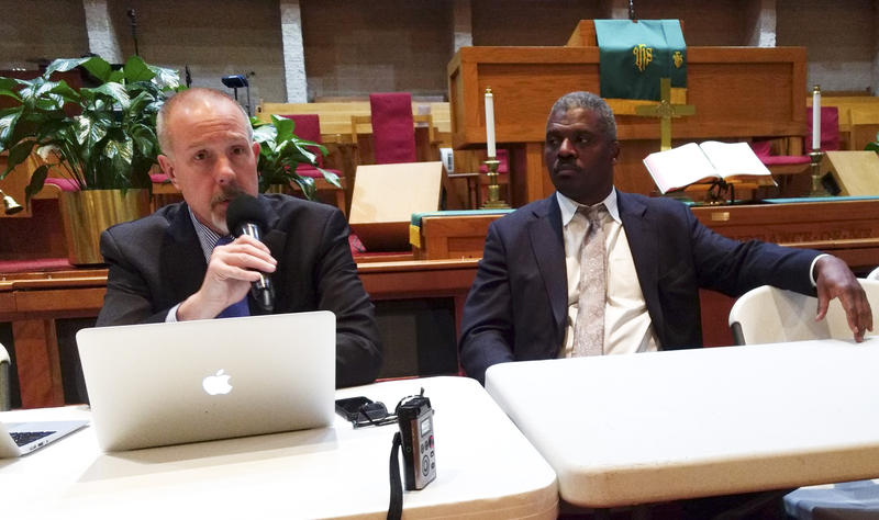 Frank Straub (left) and Rev. Jeffrey Brown of The Police Foundation talked to about 50 people at Little Rock AME Zion Church Monday night.