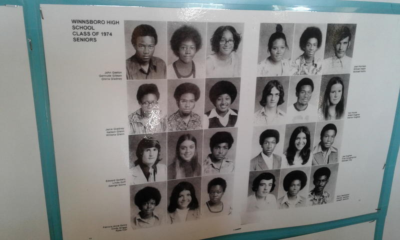 Lots of pictures from old FHS yearbooks adorn the walls. WFAE's Gwendolyn Glenn's brother is in the middle of the second left row, on the left page