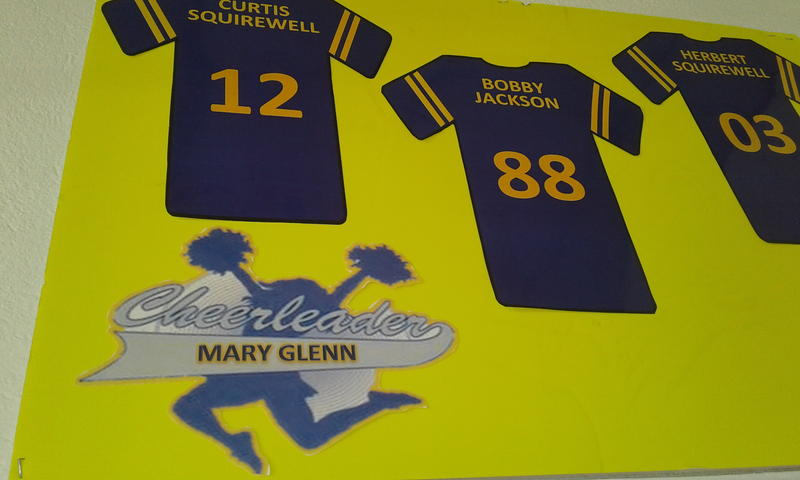 Names of FHS football players and cheerleaders adorn one wall, including WFAE's Gwendolyn Glenn's sister's name.