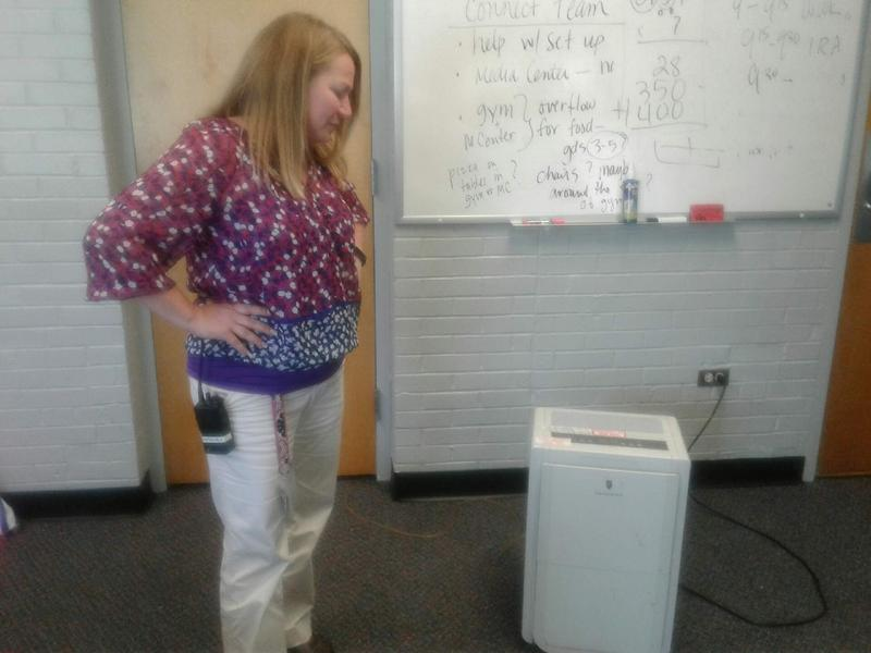 Principal Beth Marshall has gone through three dehumidifiers in her office, where the air is stagnant without it