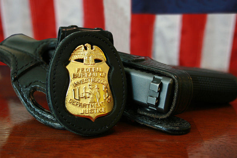 FBI badge and gun
