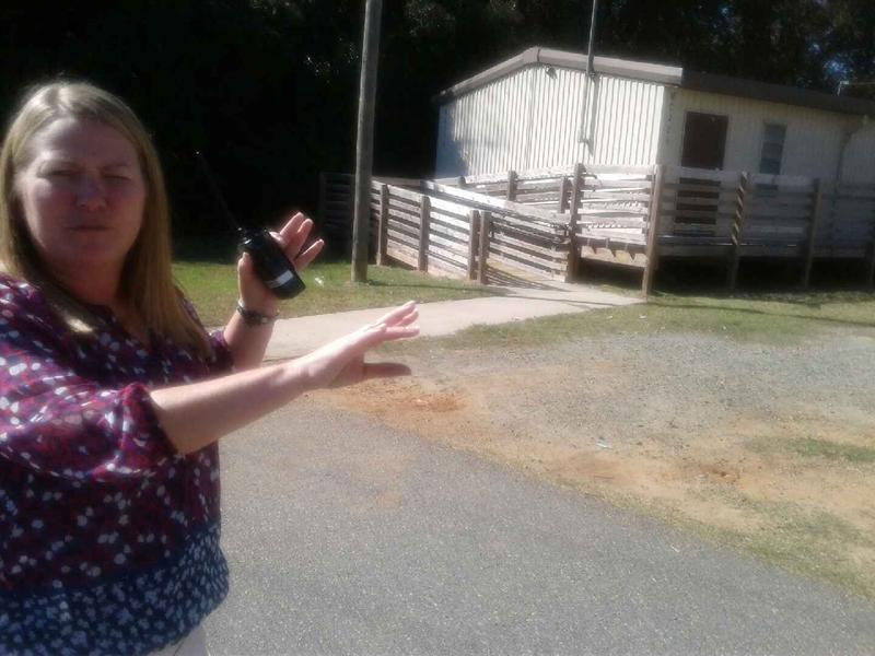 Principal Beth Marshall points to portables that house more than half of her school's students