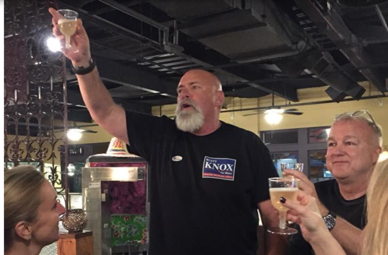 Davidson's Rusty Knox toasts supporters Tuesday night after unseating five-term mayor John Woods.