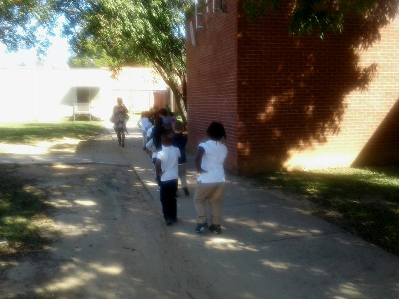 Students walk from portable classrooms to the main building at Briarwood Academy