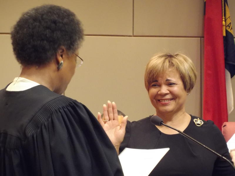 Vi Lyles takes the oath of office as Charlotte's new mayor Monday night from Superior Court Judge Yvonne Mims Evans.