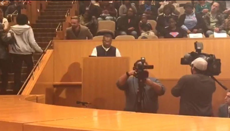 A speaker addresses the Charlotte City council Monday night, in this view from a live stream by Braxton Winston, from his seat at the council dais.