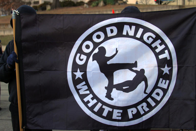 Some Antifa members waved simple red flags. Others, like this one, included slogans