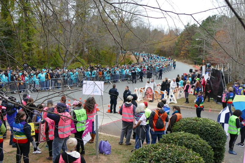 A prayer march organized by the anti-abortion group Love Life Charlotte drew thousands to a Charlotte women's clinic on Saturday.