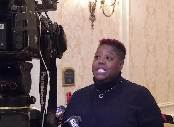 Council member LaWana Mayfield talks to reporters in a break.