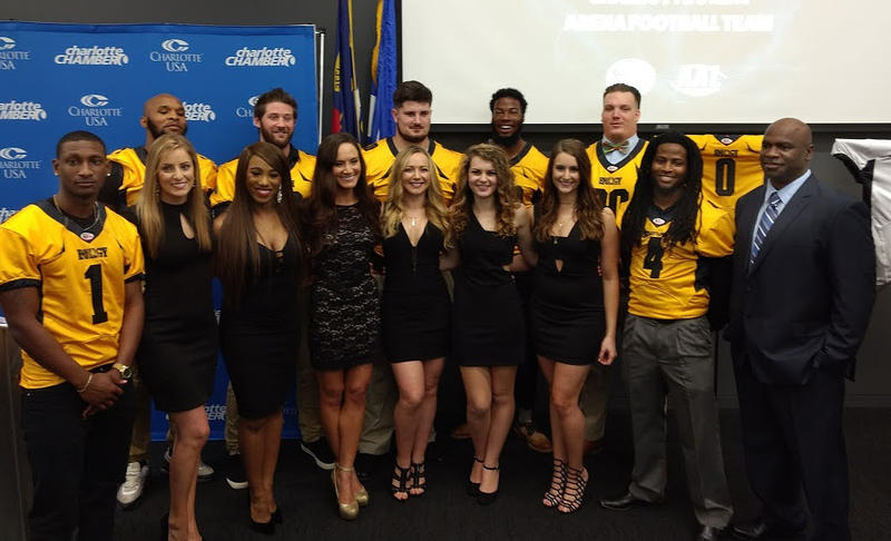 Carolina Energy players and dance team members joined coach Ervin Bryson (right) at a press conference Thursday at the Charlotte Chamber.