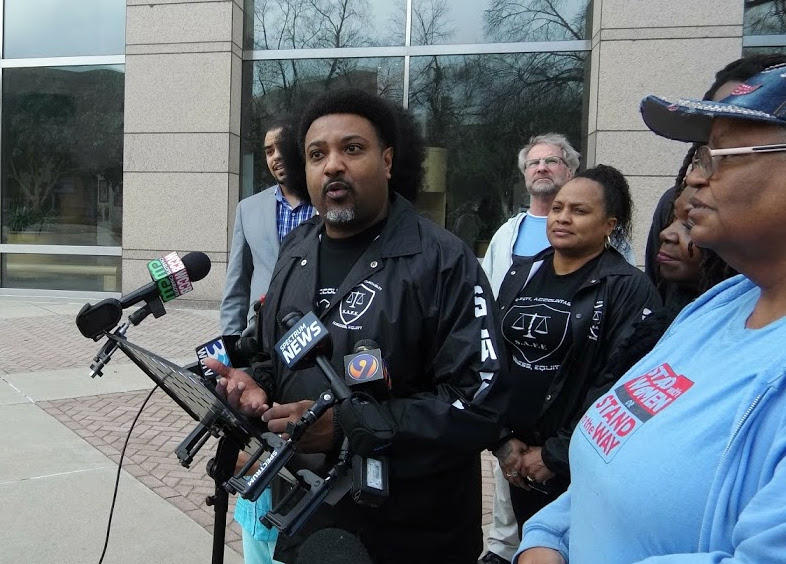 Robert Dawkins of SAFE Coalition NC led Tuesday's speakers outside the Government Center.