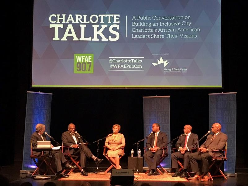 Left to right: Co-moderators Mike Collins and Qcitymetro.com's Glenn Burkins, Mayor Vi Lyles, District Attorney Spencer Merriweather, City Manager Marcus Jones, and Police Chief Kerr Putney.