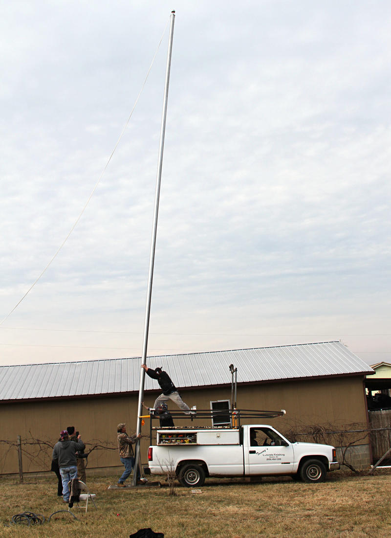 The 50 foot flagpole nearly in place.