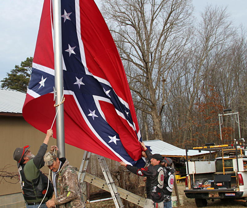 The final step is the unfurling of the Confederate flag. This one measures 10 feet by 15 feet.