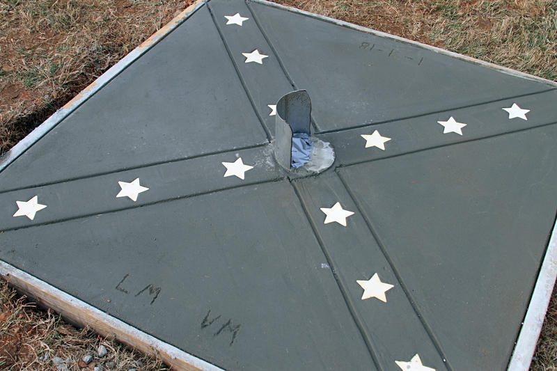 The base of the flagpole is itself a representation of the Confederate flag.