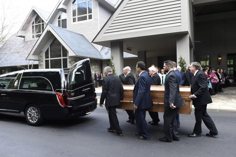 Pallbearers carry the body of Rev. Billy Graham before it leaves the Billy Graham Training Center at the Cove on Saturday, Feb. 24, 2018, in Asheville, N.C. Graham's body will be brought to his hometown of Charlotte on Saturday, Feb. 24.