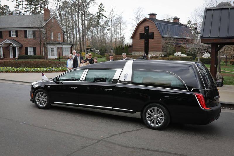 The hearse carrying Billy Graham's casket arrives at the Billy Graham Library Saturday, Feb. 24, 2018.