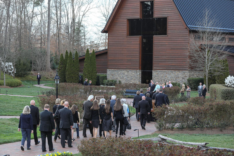 Members of Billy Graham's family make their way to his namesake library in Charlotte for a private viewing of his casket Saturday, Feb. 24, 2018.