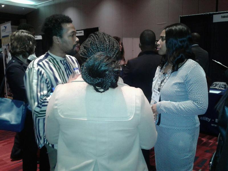 An FBI officials interviews students at the CIAA career expo