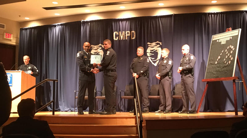 One of the class's 30 recruits accepts his law enforcement certificate.