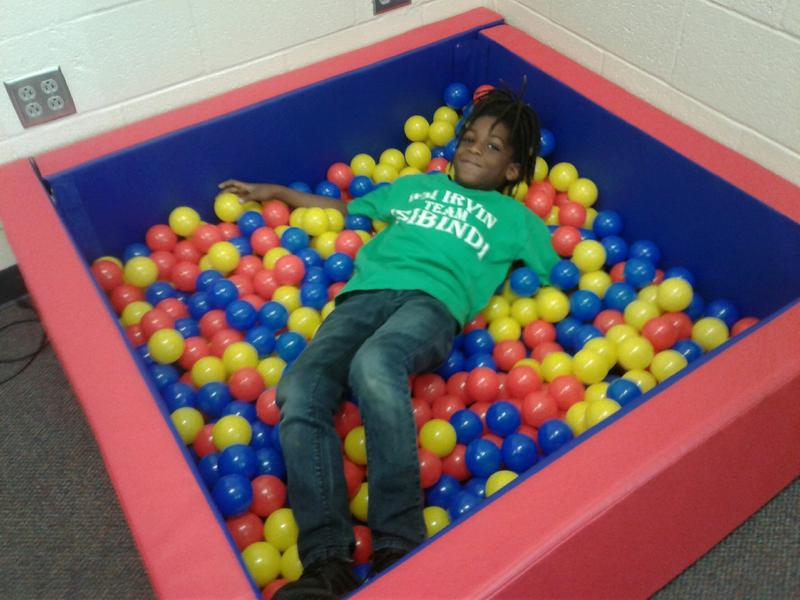 Students can relax in this box filled with soft balls midway through their Ready Body Lab workout