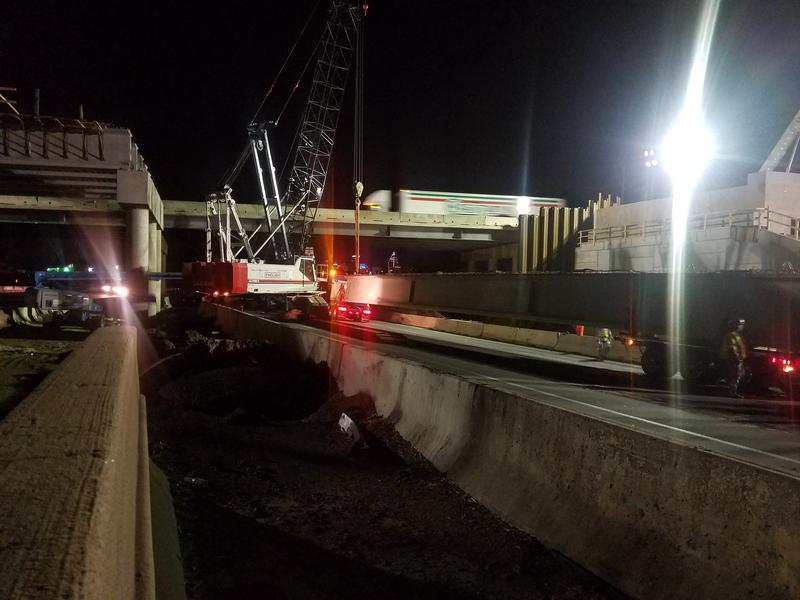 Workers installed beams in late April for a new bridge over I-77 near LaSalle Street near uptown Charlotte.