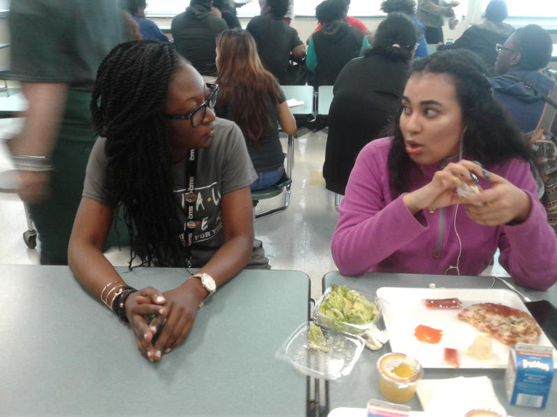 Cochrane Collegiate Academy social worker Candace Brown (left) talks to a student during the lunch break.