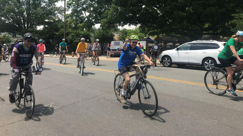 Robert Jack gives a thumbs up as riders depart Olde Mecklenburg Brewery to commemorate the ride of Captain Jack.