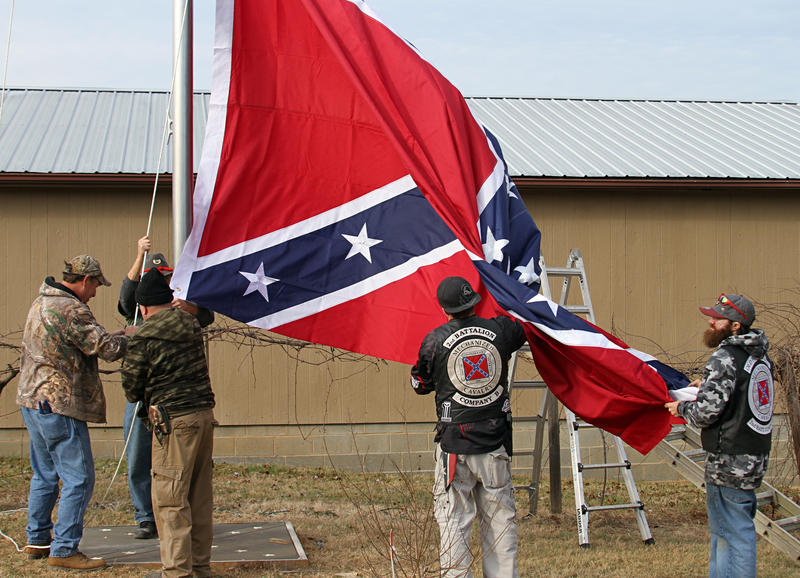 Members of the Sons of Confederate Veterans raising a large Confederate flag in Alexander County in February.
