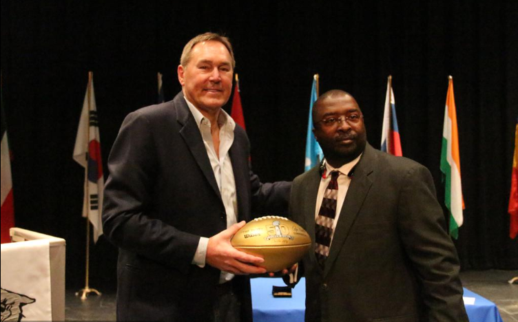 Dwight Clark, left, accepted a Golden Football Award from Garinger High School Athletic Director Tony Huggins at a ceremony in 2016