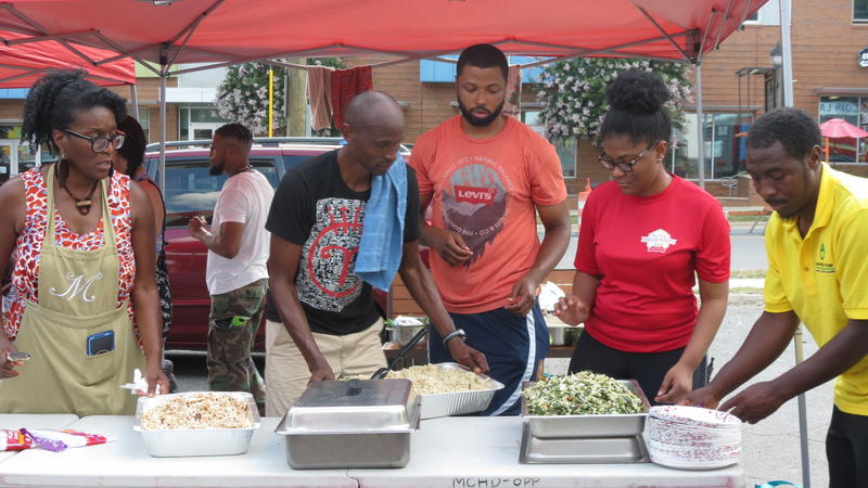 Juneteenth feast inspired by market offerings and prepared by Chef Njathi Kabui (black t-shirt). He does weekly healthy cooking demonstrations at the market