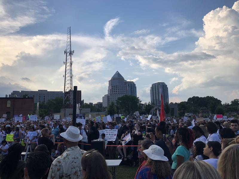 Charlotte's protest of Trump's immigration policies kicked off with speeches and ended with a vigil.
