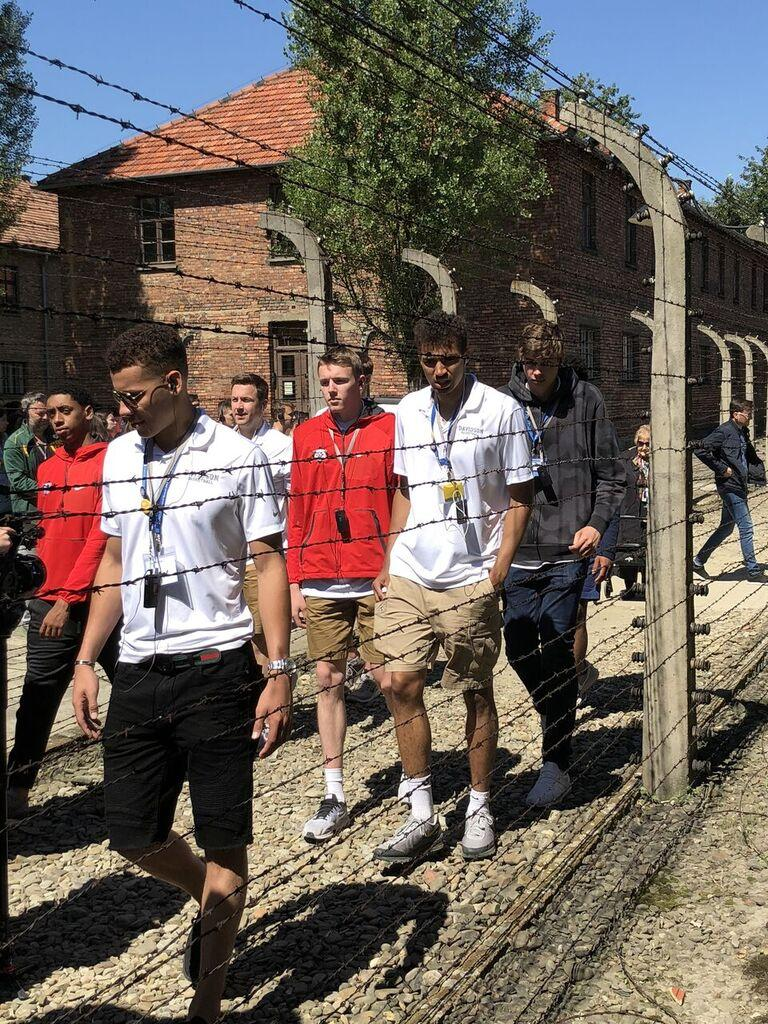 Davidson College basketball team visiting Auschwitz