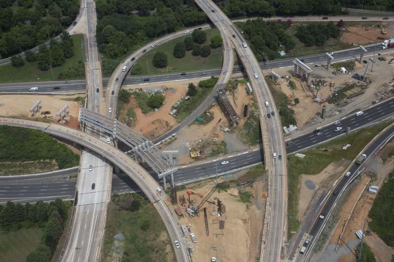 Aerial photo from June 2018 shows toll lane ramps under construction at the I-77 / I-277 interchange.